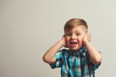 Portrait of surprised and amazed caucasian boy. Looking at the camera. Shocked child posing on white background with copyspace Stock Image