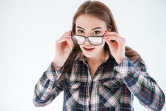Portrait of surprised attractive young woman looking over glasses Stock Photo