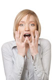 Portrait of surprised beautiful blond woman Stock Photos
