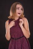 Portrait of surprised beautiful brunette woman on black backgrou Stock Photos