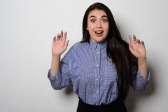 Portrait of surprised beautiful girl in casual wear with raised arms Stock Image