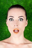 Portrait of a surprised beautiful woman mouth open. Closeup portrait of a surprised beautiful woman mouth open on green Royalty Free Stock Images