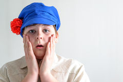 Portrait of surprised boy teenager in Russian national cap with cloves. Portrait of the surprised boy teenager in Russian national cap with cloves Royalty Free Stock Photography