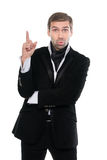 Portrait of surprised business man holding up his forefinger. Stock Photo