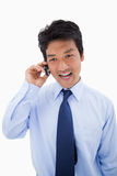 Portrait of a surprised businessman making a phone call Stock Images