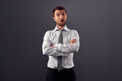 Surprised businessman over grey background Royalty Free Stock Images