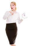 Portrait surprised businesswoman with clock. Time management. Stock Image