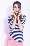 Portrait of Surprised Caucasian Brunette Girl in Hat and Striped Shirt. Royalty Free Stock Photo