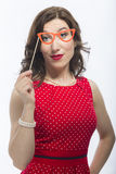Portrait of Surprised Caucasian Brunette Woman With Artistic Spectacles. In Front Of Face.Against White. Vertical Image Orientation Royalty Free Stock Photography