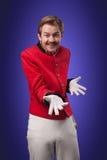 Portrait of  surprised concierge (porter). Portrait of surprised concierge (porter) in a red jacket on a gradient blue background Royalty Free Stock Images