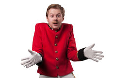 Portrait of  surprised concierge (porter). Portrait of surprised concierge (porter) in a red jacket on a on a white background. isolated Royalty Free Stock Photo