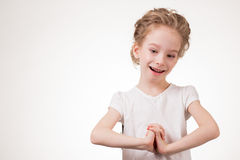 Portrait of surprised excited girl covering her mouth by the hand. Isolated on white background Royalty Free Stock Photo