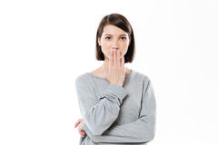 Portrait of a surprised girl covering her mouth with hand Stock Image
