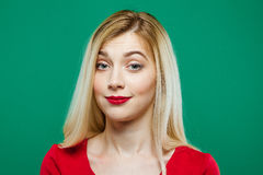 Portrait of Surprised Girl with Red Sensual Lips in Studio on Green Background. Royalty Free Stock Photos