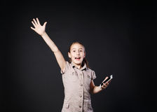 Portrait of surprised girl touch screen on mobile phone Stock Images