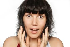Portrait of a surprised girl with wide-opened eyes Royalty Free Stock Images