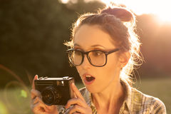 Portrait of Surprised Hipster Girl Taking a Photo Stock Photo