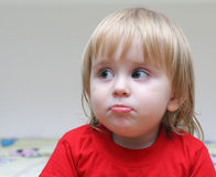 Portrait of the surprised kid. Surprised the child looks in the direction Royalty Free Stock Photos