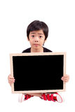 Portrait of a surprised little boy holding a billboard Stock Photography