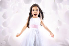 Portrait of the surprised little girl Stock Photography