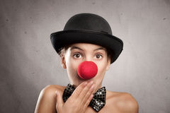 Portrait of surprised little girl with a clown nose Stock Photos