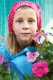 Portrait of a surprised little girl sitting in the garden  Royalty Free Stock Photos
