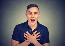 Portrait of a surprised man. Portrait of a surprised young man feeling amazed looking at camera Stock Image