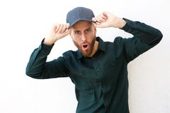 Surprised man wearing hat with open mouth. Portrait of surprised man wearing hat with open mouth Royalty Free Stock Photography