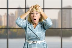 Portrait of surprised mature woman. Royalty Free Stock Photography
