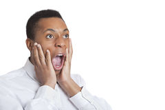 Portrait of surprised mixed race man against Indian flag Royalty Free Stock Images