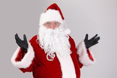 Portrait of surprised Santa Claus. Looking at camera, isolated on gray background stock images