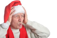 Senior man in Santa hat Stock Image