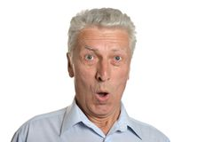 Portrait of surprised senior man Stock Photos