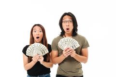 Portrait of a surprised shocked asian couple Stock Photos
