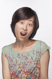 Portrait of surprised and shocked woman, studio shot Royalty Free Stock Image