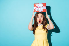 Portrait of a surprised shocked young woman in dress Royalty Free Stock Photo