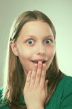 Portrait of a surprised teen girl Stock Images