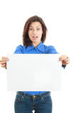Portrait of surprised woman with advert looking at camera Royalty Free Stock Photography