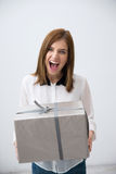 Portrait of a surprised woman holding gift Stock Photo