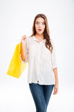 Portrait of a surprised woman holding shopping bag Stock Photos