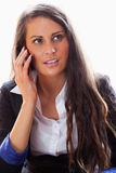 Portrait of a surprised woman on the phone Stock Photography