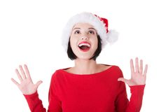 Portrait of surprised woman in santa clothes.  Stock Images