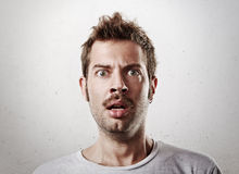 Portrait of a surprised young man Stock Images