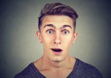 Portrait of a surprised young man looking at camera. Portrait of a surprised young man Royalty Free Stock Images