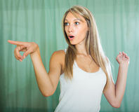 Portrait of surprised young woman Stock Images