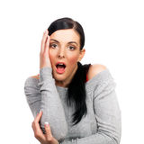 Portrait of surprised young woman isolated Royalty Free Stock Photo