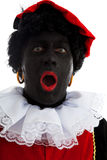 Portrait of surprised Zwarte piet ( black pete). Typical Dutch character part of a traditional event celebrating the birthday of Sinterklaas in december over Royalty Free Stock Photos