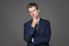 Portrait of suspicious elegant businessman. Looking in camera Stock Images