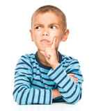 Portrait of a suspicious little boy Royalty Free Stock Image