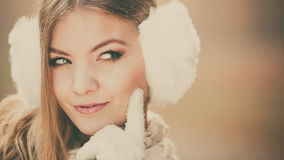 Portrait of suspicious pretty woman in earmuffs Stock Images
